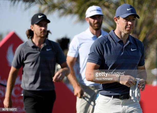 Rory McIlroy of Northern Ireland Dustin Johnson of the United States and Tommy Fleetwood of England walk from the 14th tee during round two of the...