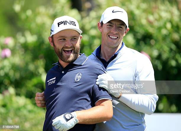 Rory McIlroy of Northern Ireland enjoying a fun moment with Andy Sullivan of England during practice for the 2016 World Golf Championships Dell Match...