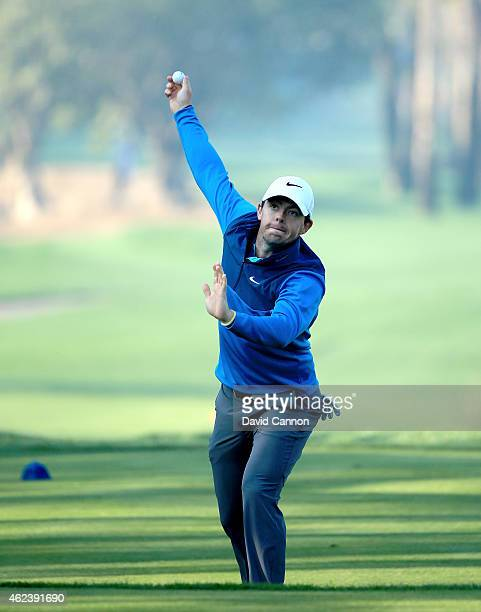 Rory McIlroy of Northern Ireland enjoys a little piece of cricket bowling practice with Ernie Els on the 5th tee during the ProAm as a preview for...