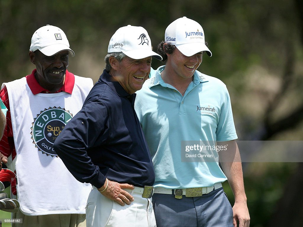 Rory McIlroy of Northern Ireland (R) enjoys his time with South African Golf Legend Gary Player (C) on the 16th tee during the pro-am as a preview for the 2009 Nedbank Golf Challenge at the Gary Player Country Club Course on December 2, 2009 in Sun City, South Africa.