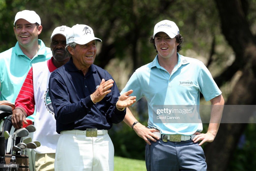 Rory McIlroy of Northern Ireland (R) enjoys his time with South African Golf Legend Gary Player (2nd L) on the 16th tee during the pro-am as a preview for the 2009 Nedbank Golf Challenge at the Gary Player Country Club Course on December 2, 2009 in Sun City, South Africa.