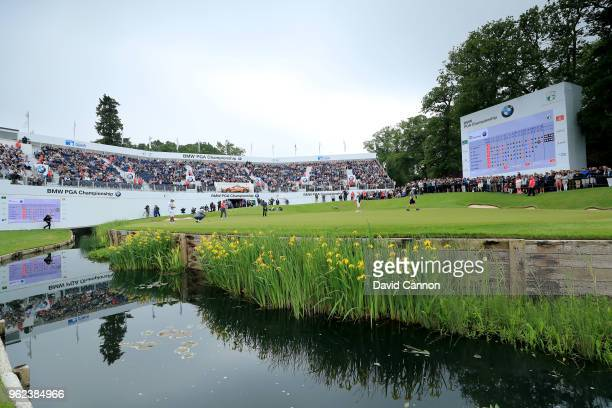 Rory McIlroy of Northern Ireland finishes out on the par 5, 18th hole during the second round of the 2018 BMW PGA Championship on the West Course at...