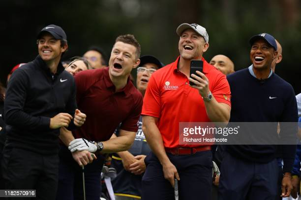 Rory McIlroy of Northern Ireland former rugby player Brian O'Driscoll of Ireland former rugby player Mike Tindall of England and Tiger Woods of the...