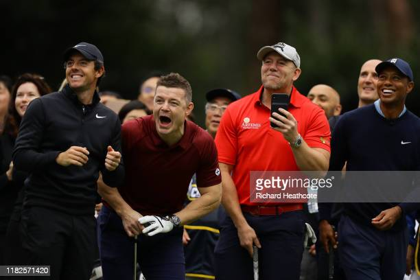 Rory McIlroy of Northern Ireland, former rugby player Brian O'Driscoll of Ireland, former rugby player Mike Tindall of England and Tiger Woods of the...
