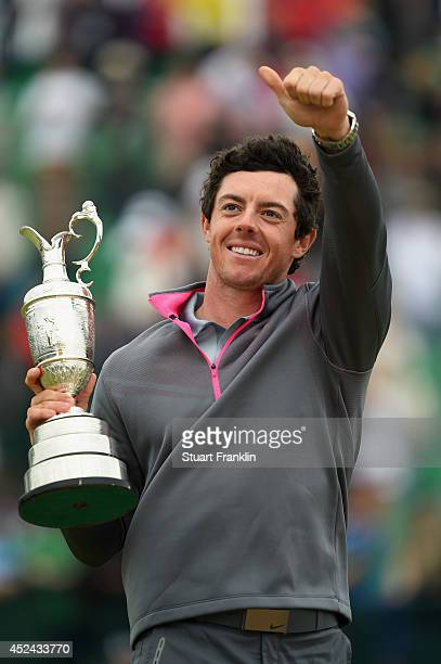 Rory McIlroy of Northern Ireland gives a thumbs up as he holds the Claret Jug after his twostroke victory at The 143rd Open Championship at Royal...