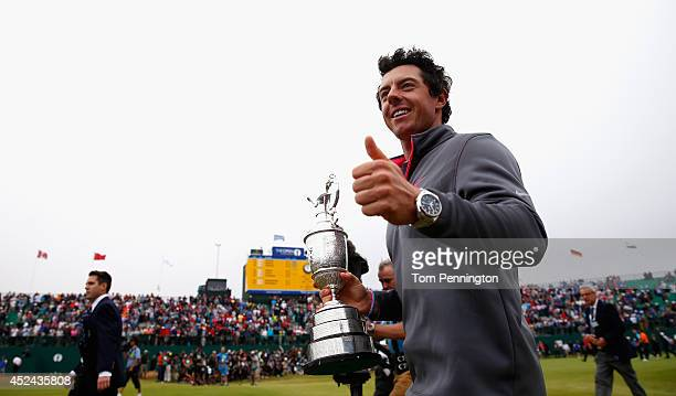 Rory McIlroy of Northern Ireland gives a thumbs up to the crowd after his twostroke victory at The 143rd Open Championship at Royal Liverpool on July...