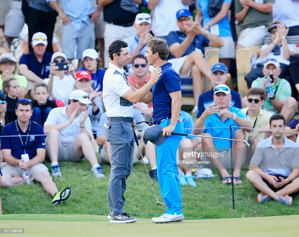 Rory McIlroy of Northern Ireland (L) greets Thorbjorn Olesen of Denmark on the 18th green after McIlroy won their match 1up during the first round of the World Golf Championships-Dell Match Play at the Austin Country Club on March 23, 2016 in Austin, Texas.