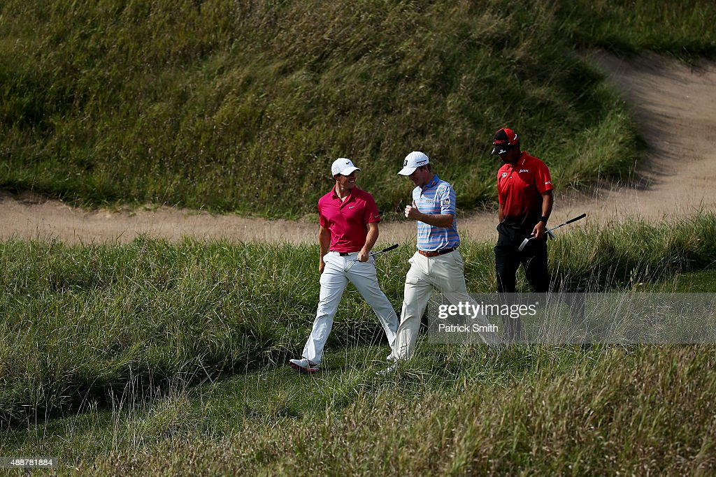 Rory McIlroy of Northern Ireland, Hideki Matsuyama of Japan and Brandt Snedeker walk on the 17th hole during the First Round of the BMW Championship at Conway Farms Golf Club on September 17, 2015 in Lake Forest, Illinois.