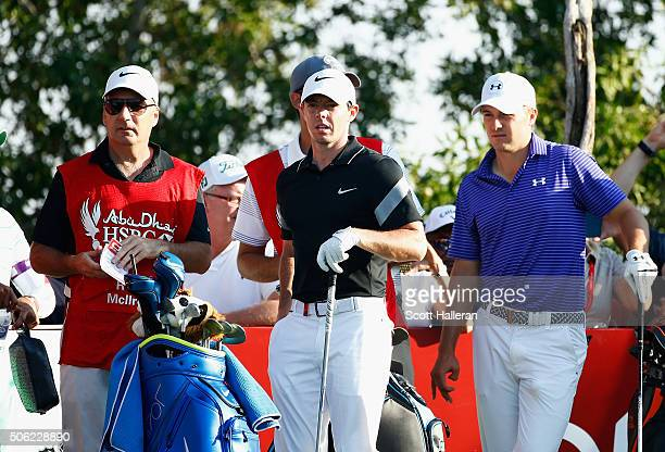 Rory McIlroy of Northern Ireland his caddie JP Fitzgerald and Jordan Spieth of the United States look on from the 8th tee during the second round of...
