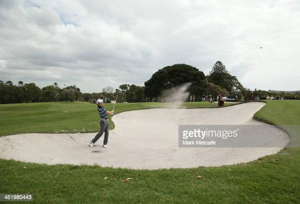 Rory McIlroy of Northern Ireland hits a bunker shot during a practice round ahead of the 2013 Australian Open at Royal Sydney Golf Club on November...