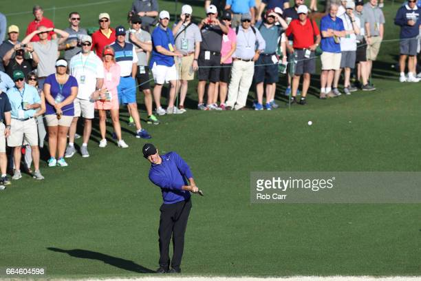 Rory McIlroy of Northern Ireland hits a chip shot during a practice round prior to the start of the 2017 Masters Tournament at Augusta National Golf...