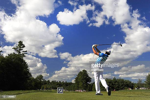 Rory McIlroy of Northern Ireland hits a drive on the tenth hole during the final round of the Deutsche Bank Championship at TPC Boston on September 3...