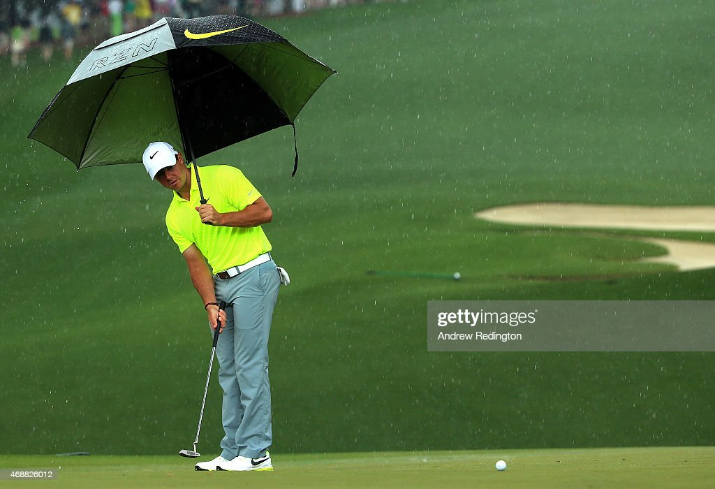Rory McIlroy of Northern Ireland hits a putt in the rain during a practice round prior to the start of the 2015 Masters Tournament at Augusta National Golf Club on April 7, 2015 in Augusta, Georgia.