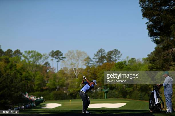 Rory McIlroy of Northern Ireland hits a shot during a practice round prior to the start of the 2013 Masters Tournament at Augusta National Golf Club...