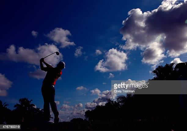 Rory McIlroy of Northern Ireland hits a shot during a practice round prior to the start of the World Golf Championships-Cadillac Championship at...