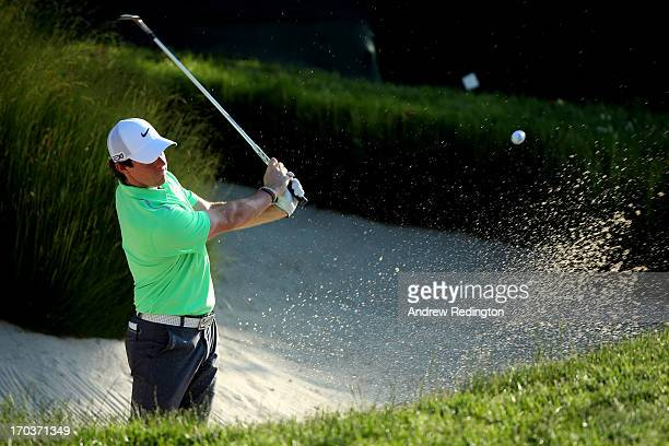 Rory McIlroy of Northern Ireland hits a shot from a bunker during a practice round prior to the start of the 113th U.S. Open at Merion Golf Club on...