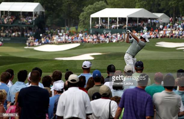 Rory McIlroy of Northern Ireland hits a shot on the 14th hole during the final round on his way to winning the Quail Hollow Championship at Quail...