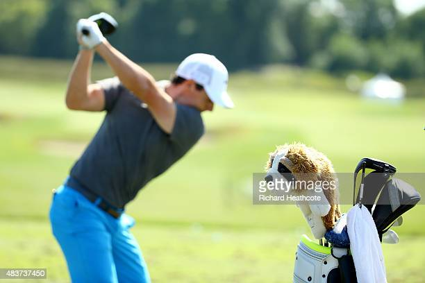 Rory McIlroy of Northern Ireland hits a shot on the practice ground during a practice round prior to the 2015 PGA Championship at Whistling Straits...