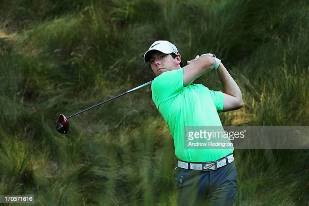 Rory McIlroy of Northern Ireland hits a tee shot during a practice round prior to the start of the 113th U.S. Open at Merion Golf Club on June 12,...