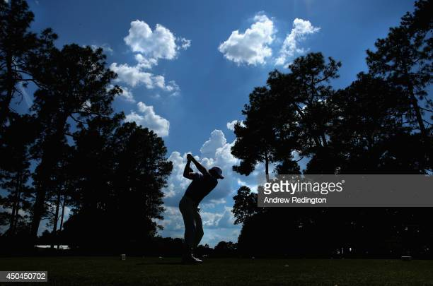 Rory McIlroy of Northern Ireland hits a tee shot during a practice round prior to the start of the 114th US Open at Pinehurst Resort Country Club...
