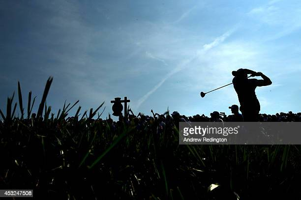 Rory McIlroy of Northern Ireland hits a tee shot during a practice round prior to the start of the 96th PGA Championship at Valhalla Golf Club on...