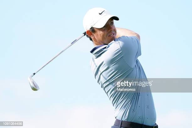Rory McIlroy of Northern Ireland hits a tee shot on the 13th hole during the final round of the Sentry Tournament of Champions at the Plantation...
