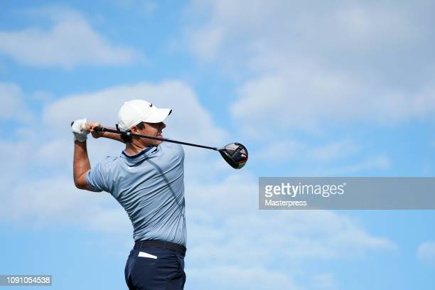 Rory McIlroy of Northern Ireland hits a tee shot on the 14th hole during the final round of the Sentry Tournament of Champions at the Plantation...