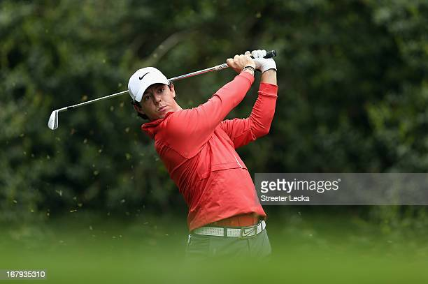 Rory McIlroy of Northern Ireland hits a tee shot on the 14th hole during the first round of the Wells Fargo Championship at Quail Hollow Club on May...