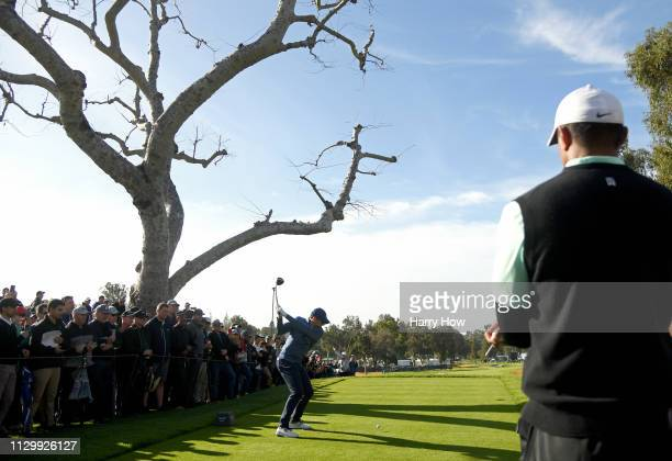 Rory McIlroy of Northern Ireland hits a tee shot on the 3rd hole during the continuation of the first round of the Genesis Open at Riviera Country...