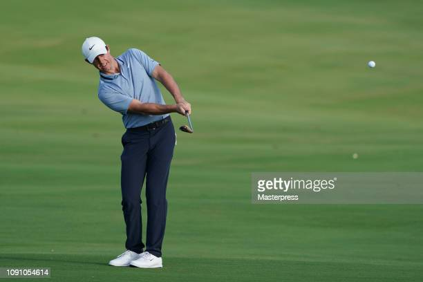 Rory McIlroy of Northern Ireland hits an approach on the 18th hole during the final round of the Sentry Tournament of Champions at the Plantation...