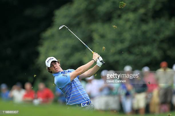 Rory McIlroy of Northern Ireland hits an approach shot to make eagle from the fairway on the eighth hole during the second round of the 111th U.S....
