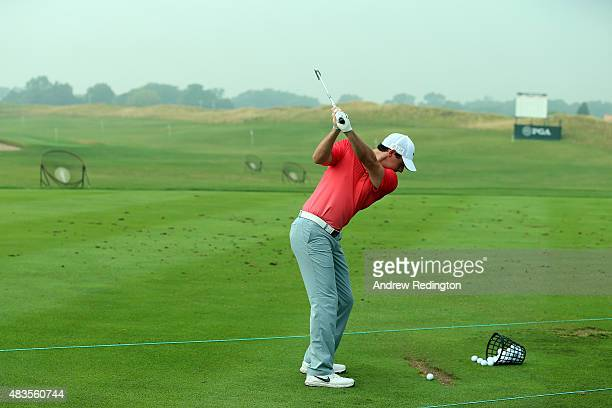Rory McIlroy of Northern Ireland hits balls on the range during a practice round prior to the 2015 PGA Championship at Whistling Straits on on August...