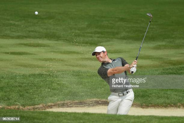 Rory McIlroy of Northern Ireland hits from a bunlker on the 3rd hole during the third round of the BMW PGA Championship at Wentworth on May 26 2018...