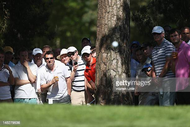 Rory McIlroy of Northern Ireland hits from behind a tree to the 10th green during the second round of the BMW PGA Championship on the West Course at...