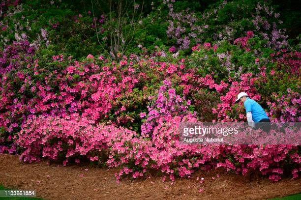 Rory McIlroy of Northern Ireland hits from the azalea's on No. 13 during the third round of the Masters at Augusta National Golf Club, Saturday,...