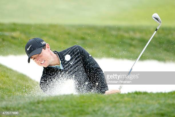 Rory McIlroy of Northern Ireland hits from the bunker on the fifth hole during his championship match in the World Golf Championships Cadillac Match...