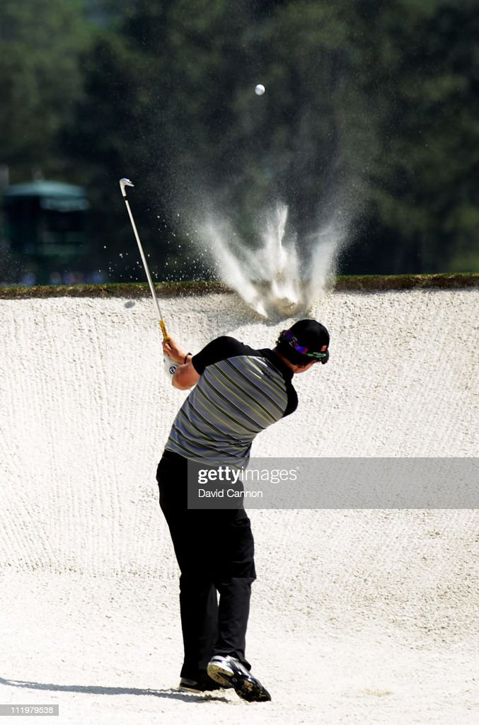 Rory McIlroy of Northern Ireland hits from the bunker on the second hole during the final round of the 2011 Masters Tournament on April 10, 2011 in Augusta, Georgia.