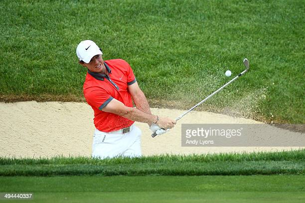 Rory McIlroy of Northern Ireland hits from the sand on the 17th hole during the first round of the Memorial Tournament presented by Nationwide...