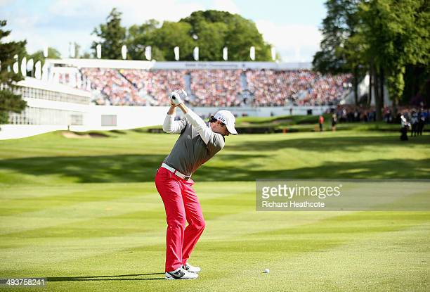 Rory McIlroy of Northern Ireland hits his 2nd shot on the 18th hole during day four of the BMW PGA Championship at Wentworth on May 25 2014 in...