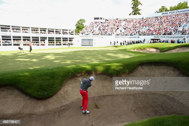 Rory McIlroy of Northern Ireland hits his 3rd shot on the 18th hole during day four of the BMW PGA Championship at Wentworth on May 25 2014 in...