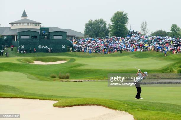Rory McIlroy of Northern Ireland hits his approach shot on the 18th hole during the second round of the 96th PGA Championship at Valhalla Golf Club...