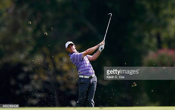 Rory McIlroy of Northern Ireland hits his approach shot on the eighth hole during the first round of the TOUR Championship by Coca-Cola at the East...