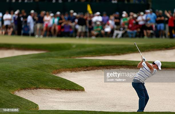 Rory McIlroy of Northern Ireland hits his approach shot on the first hole during the first round of the Shell Houston Open at the Redstone Golf Club...