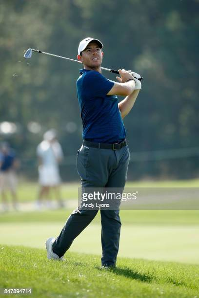Rory McIlroy of Northern Ireland hits his approach shot on the ninth hole during the third round of the BMW Championship at Conway Farms Golf Club on...