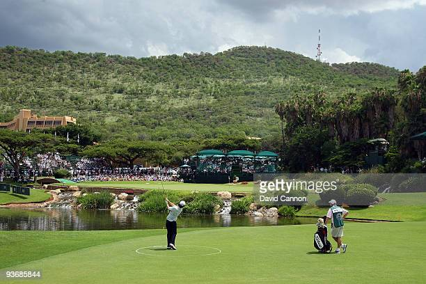 Rory McIlroy of Northern Ireland hits his fourth shot at the 9th hole during the first round of the Nedbank Golf Challenge at the Gary Player Country...