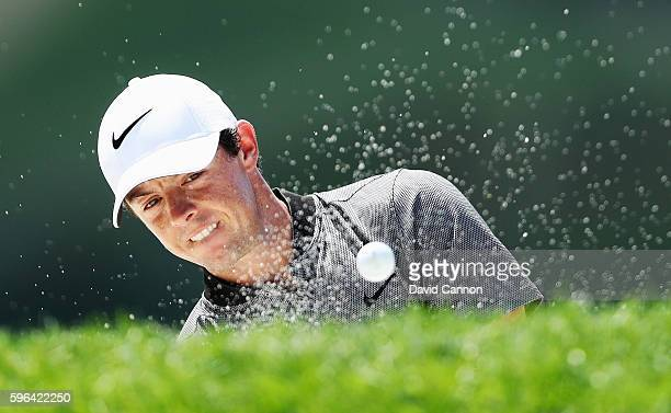 Rory McIlroy of Northern Ireland hits his fourth shot from a bunker on the fourth hole during the third round of The Barclays in the PGA Tour...