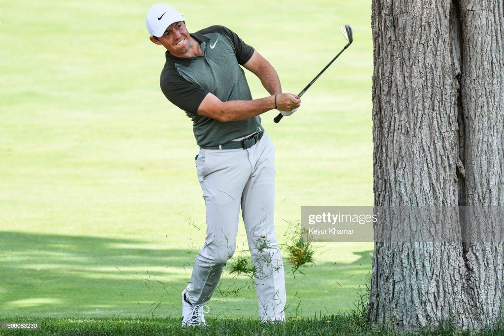 Rory McIlroy of Northern Ireland hits his second shot from behind a tree on the 18th hole during the third round of the Memorial Tournament presented by Nationwide at Muirfield Village Golf Club on June 2, 2018 in Dublin, Ohio.