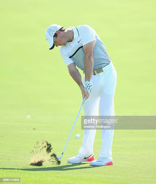 Rory McIlroy of Northern Ireland hits his second shot on the 12th hole during the final round of the DP World Tour Championship on the Earth Course...