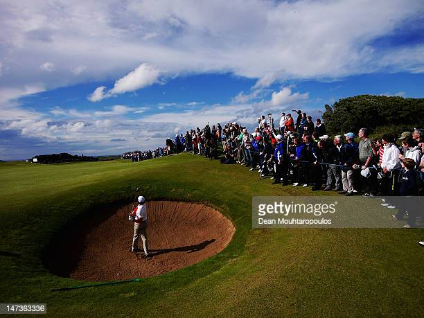 Rory McIlroy of Northern Ireland hits his second shot on the 13th hole during Day One of the 2012 Irish Open held on the Dunluce Links at Royal...