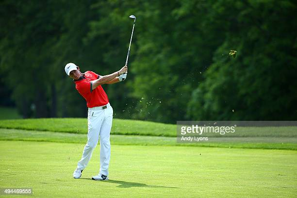 Rory McIlroy of Northern Ireland hits his second shot on the 13th hole during the first round of the Memorial Tournament presented by Nationwide...